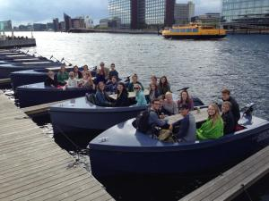 "Our class learning about ""Go Boats"" an example of sustainable entrepreneurship by the harbor."